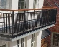 balcony-in-steel-with-wooden-handrail
