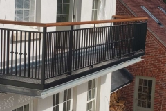 balcony-in-steel-with-wooden-handrail