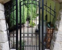 metal-gate-stone-arch